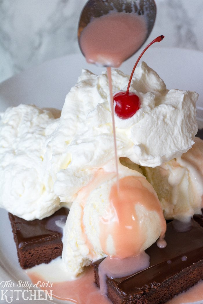 Dr Pepper Cherry Brownie Sundae, a classic, family style brownie sundae topped off with a white chocolate Dr Pepper Cherry syrup! from ThisSillyGirlsKitchen.com #CollegeFootballChampSweeps #ad