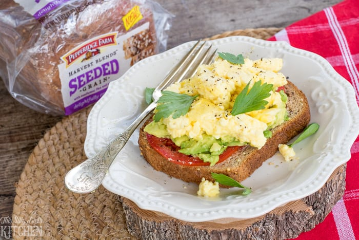 Scrambled Egg Avocado Toast, a filling, yummy breakfast or snack! from ThisSillyGirlsKitchen.com #ad #HarvestBlends