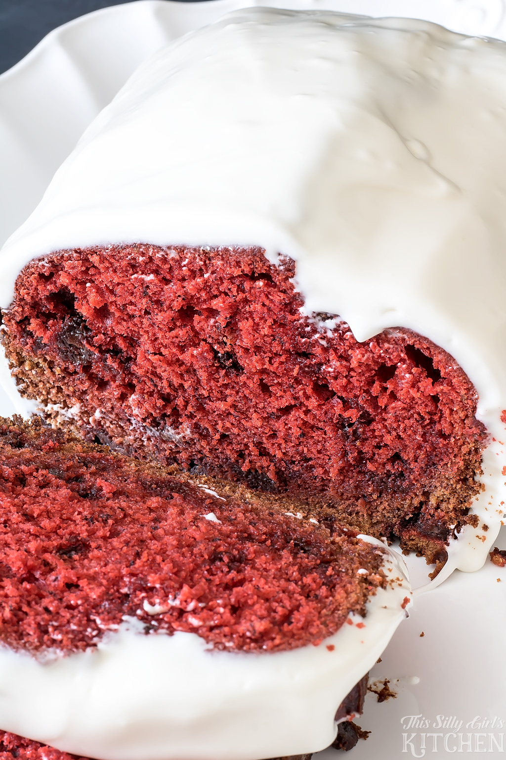 AD Chocolate Chip Red Velvet Banana Bread, classic banana bread and everyone's favorite cake, red velvet in one! Topped with thick cream cheese icing, swoon. from ThisSillyGirlsKitchen.com #groceryhero