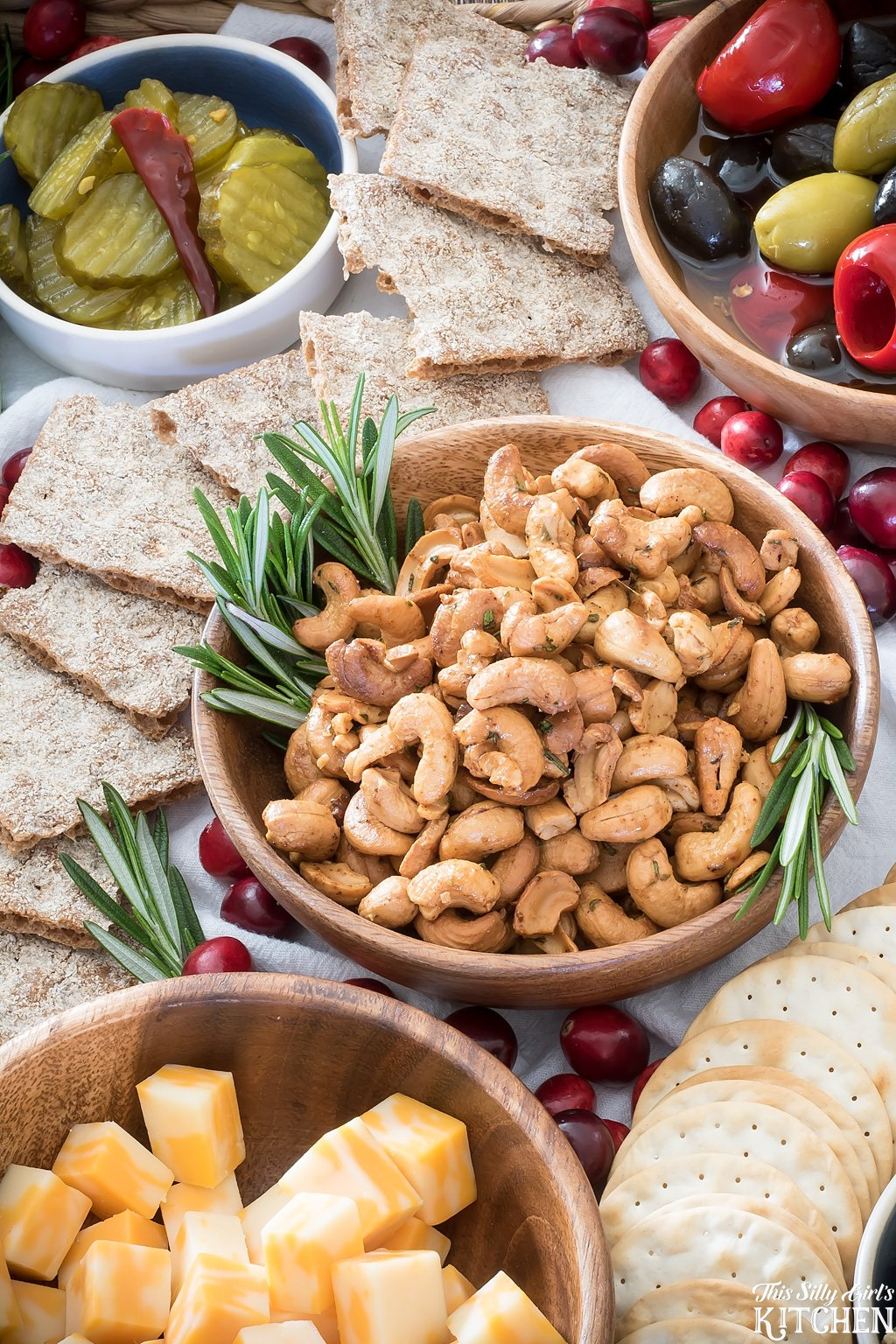 Spicy Rosemary Roasted Cashews, a delicious accompaniment to any spread! from ThisSillyGirlsKitchen.com
