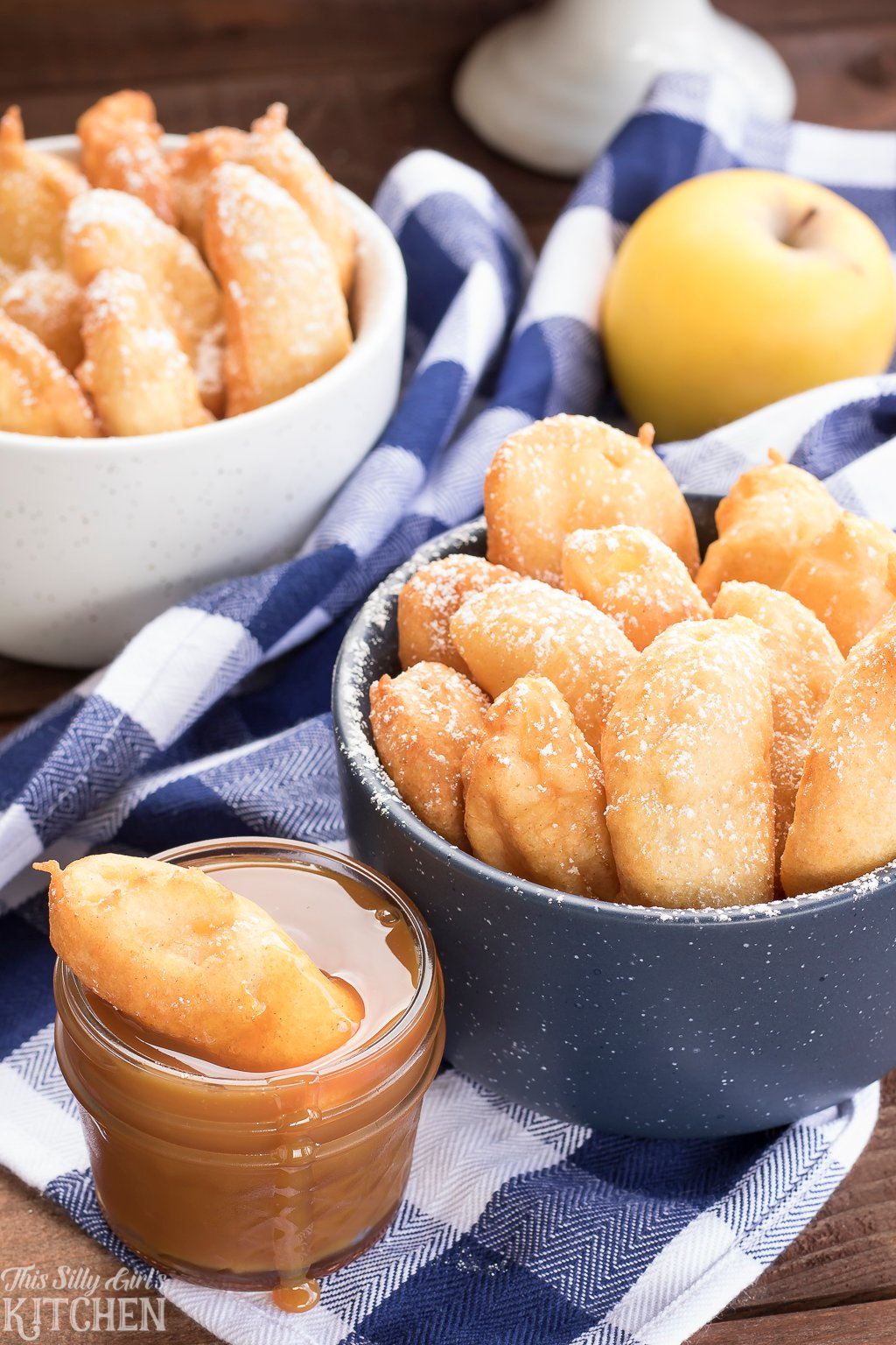Funnel Cake Apple Fries, fresh apple slices are dipped in funnel cake batter and fried to golden brown. from ThisSillyGirlsKitchen.com