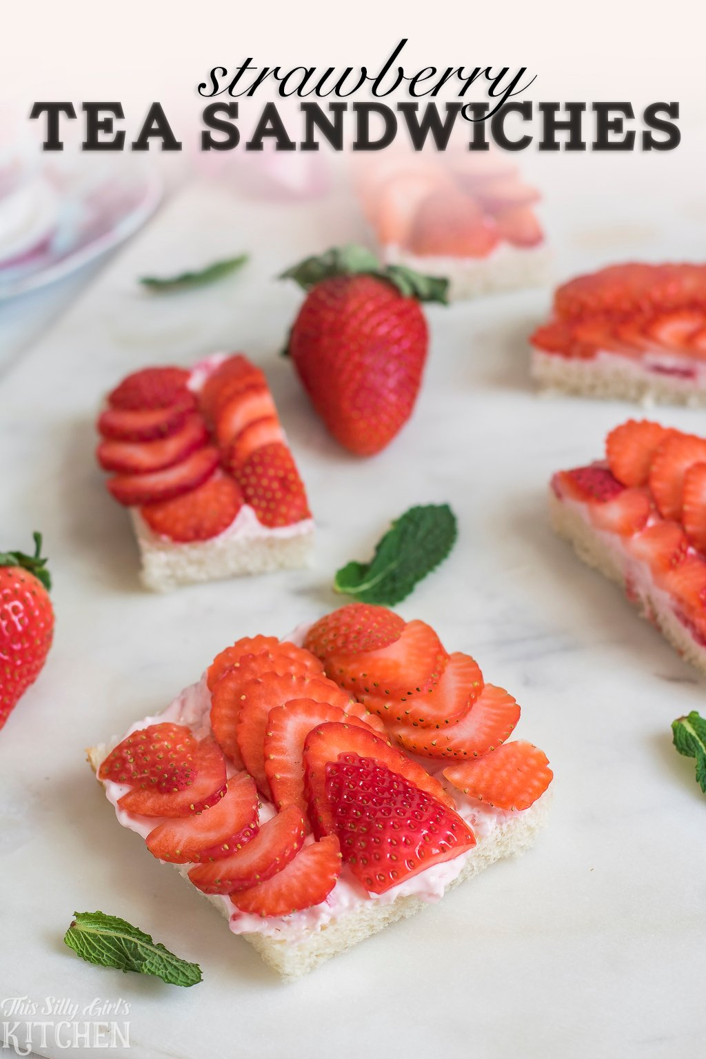 Strawberry Tea Sandwiches, homemade fresh strawberry cream cheese spread on top of simple white bread with sliced strawberries. Perfect for tea-time! Recipe from ThisSillyGirlsKitchen.com