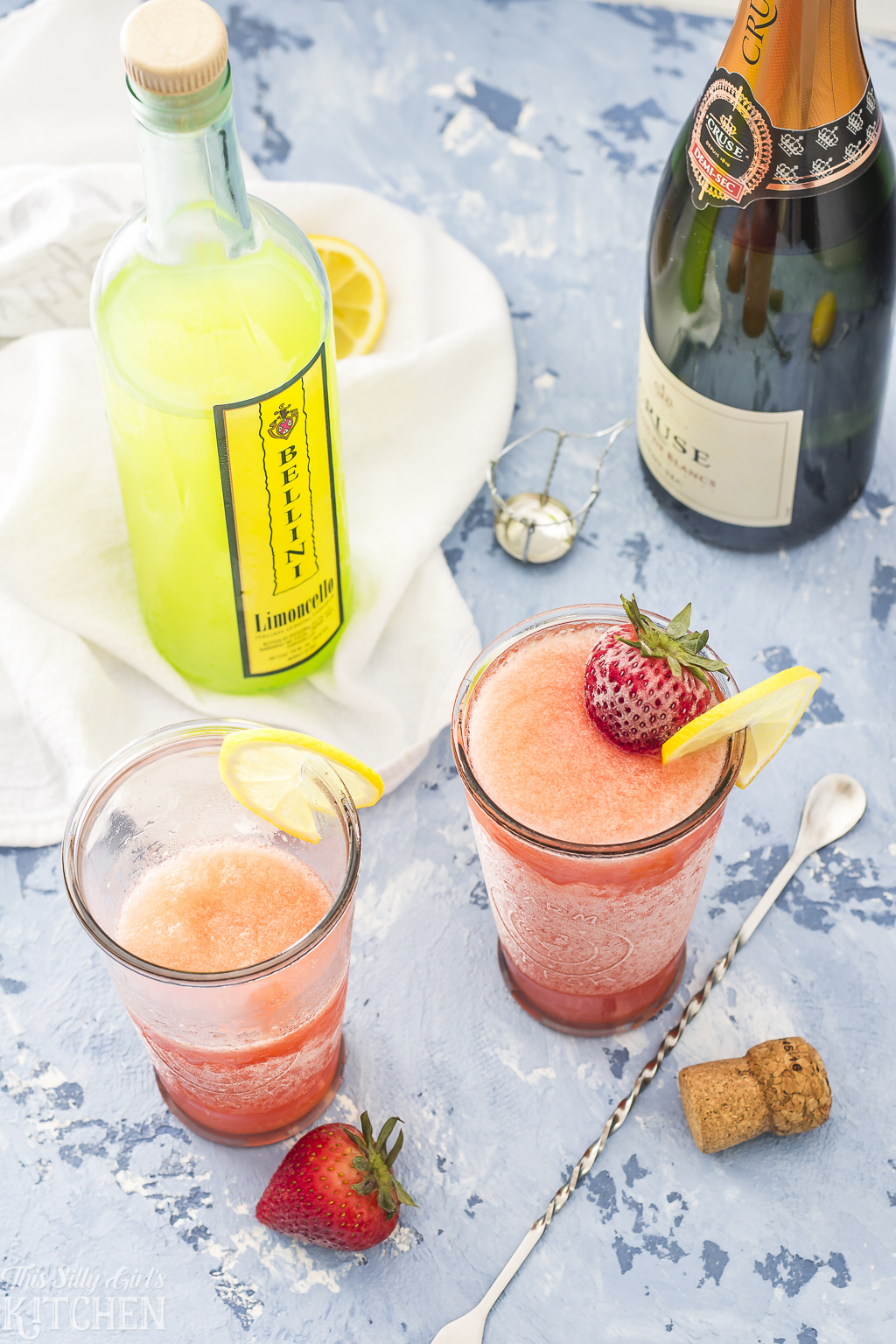 Strawberry Limoncello Slush, a refreshing adult slushie perfect for summer! Recipe from ThisSillyGirlsKitchen.com @TotalWine #totalwine