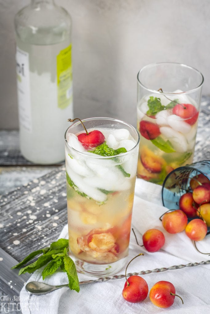 Rainier Cherry Mojitos, Fresh Rainier Cherries muddled with mint leaves, mixed with rum and fizzy soda! Recipe from ThisSillyGirlsKitchen.com