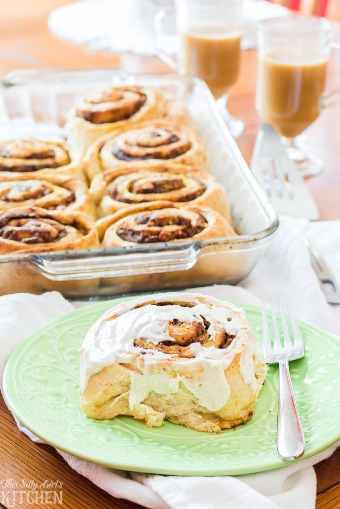 Pumpkin Crunch Cinnamon Rolls, homemade cinnamon rolls packed with a pumpkin punch and secret ingredient frosting! Recipe from ThisSillyGirlsKitchen.com #cinnamonrolls #pumpkin #fall
