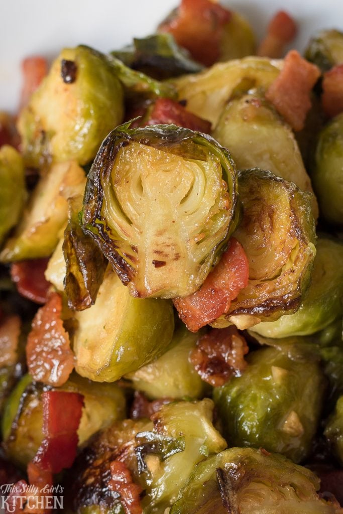 Bacon Roasted Brussel Sprouts with a sweet and tangy glaze is sure to be a huge hit on any dinner table. Especially perfect for the holidays! Recipe from ThisSillyGirlsKitchen.com