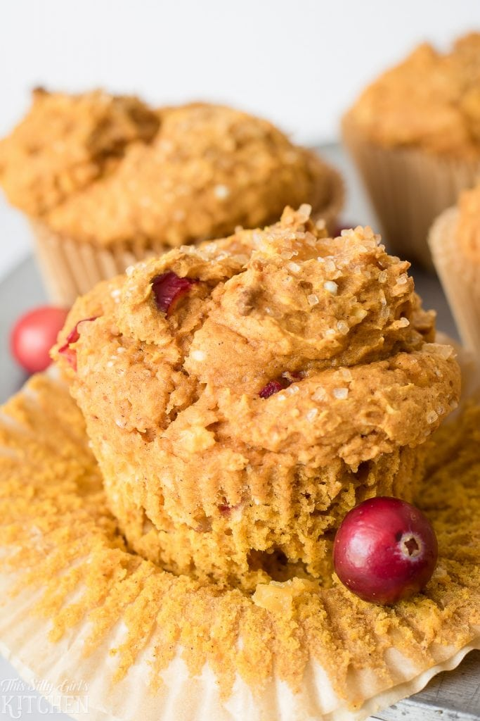 Cranberry Pumpkin Muffins, loaded with fresh cranberries, Honeycrisp apples, and of course, pumpkin! Simple, easy, and delicious! Recipe from ThisSillyGirlsKitchen.com