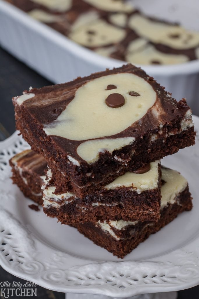 Cheesecake Brownies, made with fun ghost shapes, perfect for Halloween! Recipe from ThisSillyGirlsKitchen.com