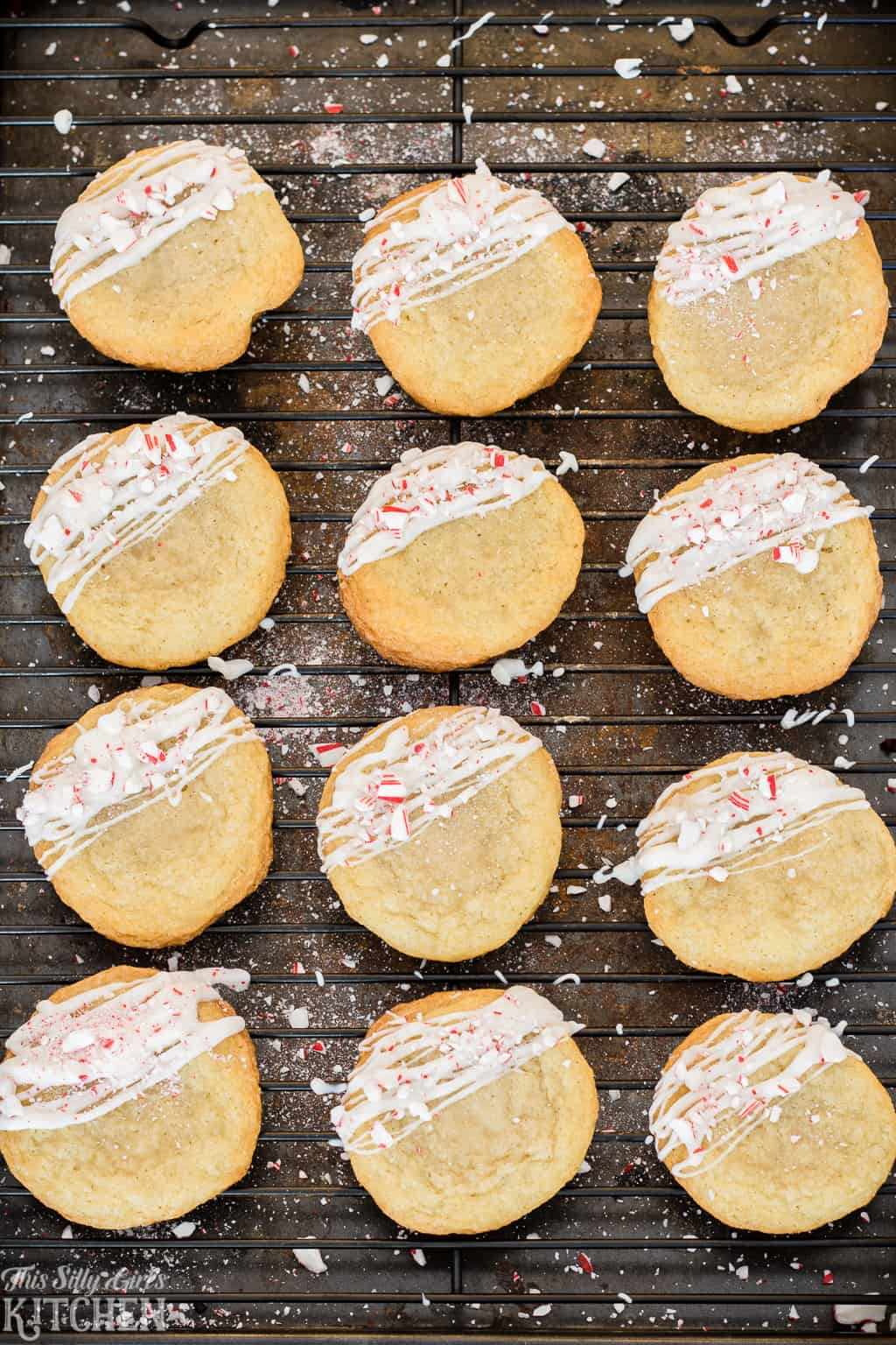 White Chocolate Peppermint Sugar Cookies, classic chewy soft sugar cookies drizzled with white chocolate and crushed peppermint! #Recipe from ThisSillyGirlsKitchen.com #sugarcookies #ChristmasCookies #peppermint #whitechocolate