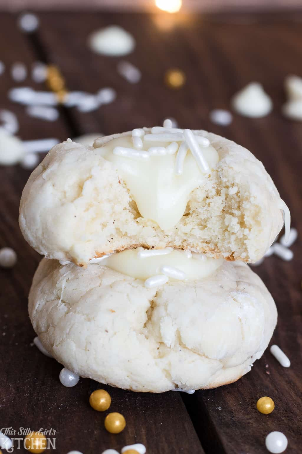 White Chocolate Thumbprint Cookies, soft cream cheese cookies filled with white chocolate ganache! #Recipe from ThisSillyGirlsKitchen.com #thumbprintcookies #cookies #whitechocolate