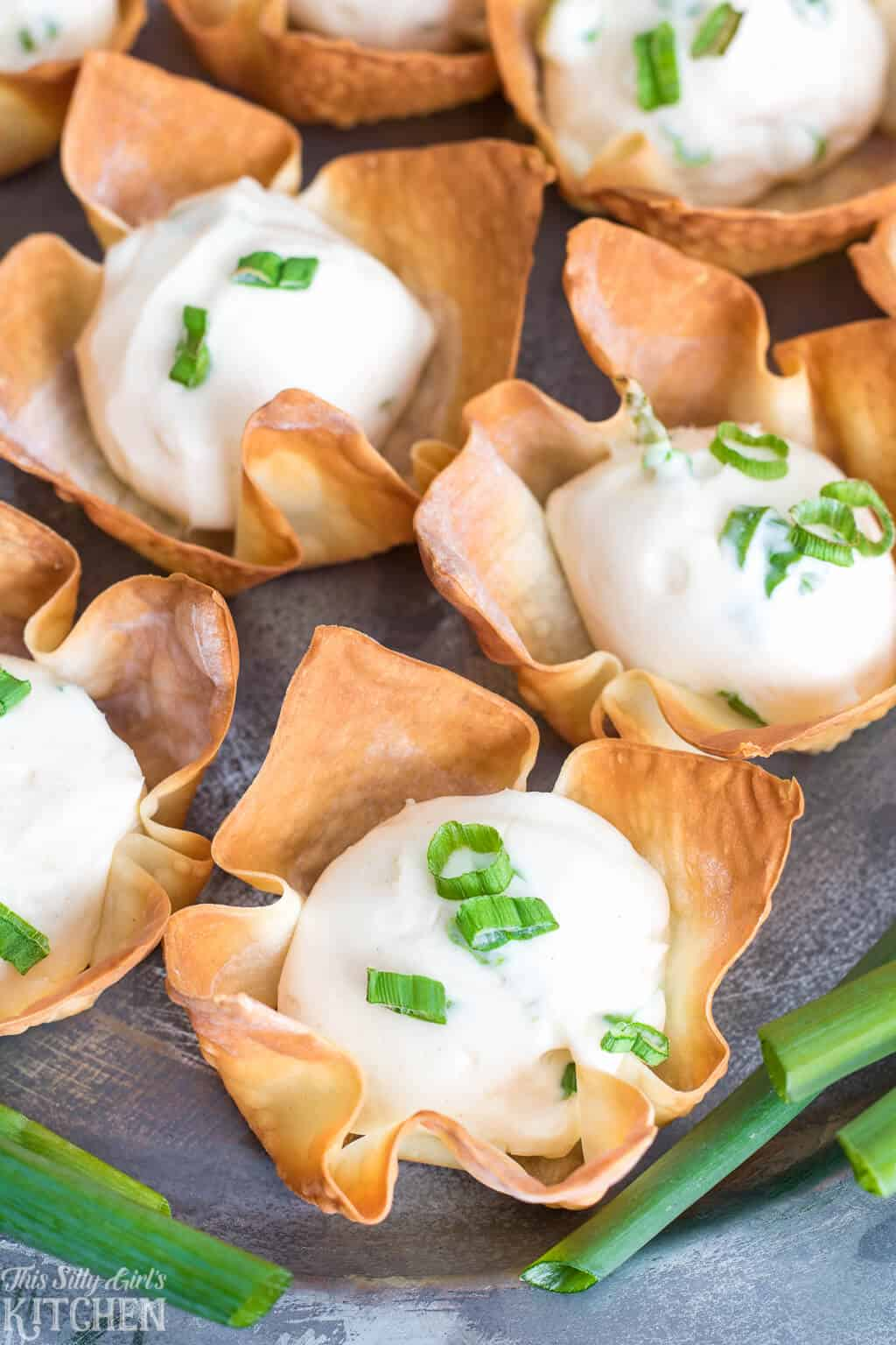 Baked Cream Cheese Wonton Cups, better than takeout and ready in under 20 minutes! #Recipe from ThisSillyGirlsKitchen.com #creamcheese #wontons #wontoncups #appetizer