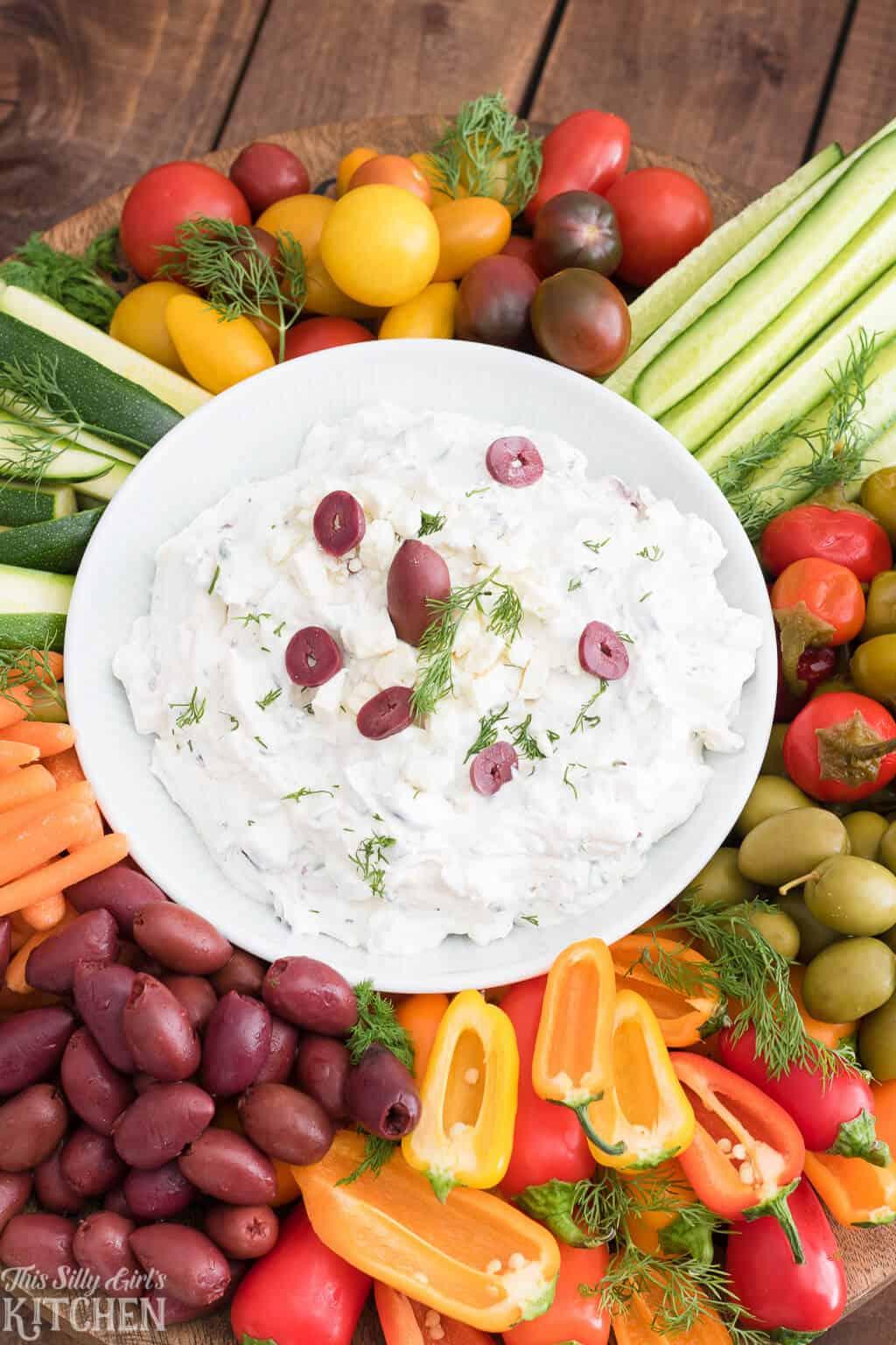 Greek Yogurt Dip, a creamy crowd-pleasing yogurt dip, loaded with traditional Greek flavors! #recipe from ThisSillyGirlsKitchen.com #greekyogurtdip #easy #greekyogurtdipforveggies