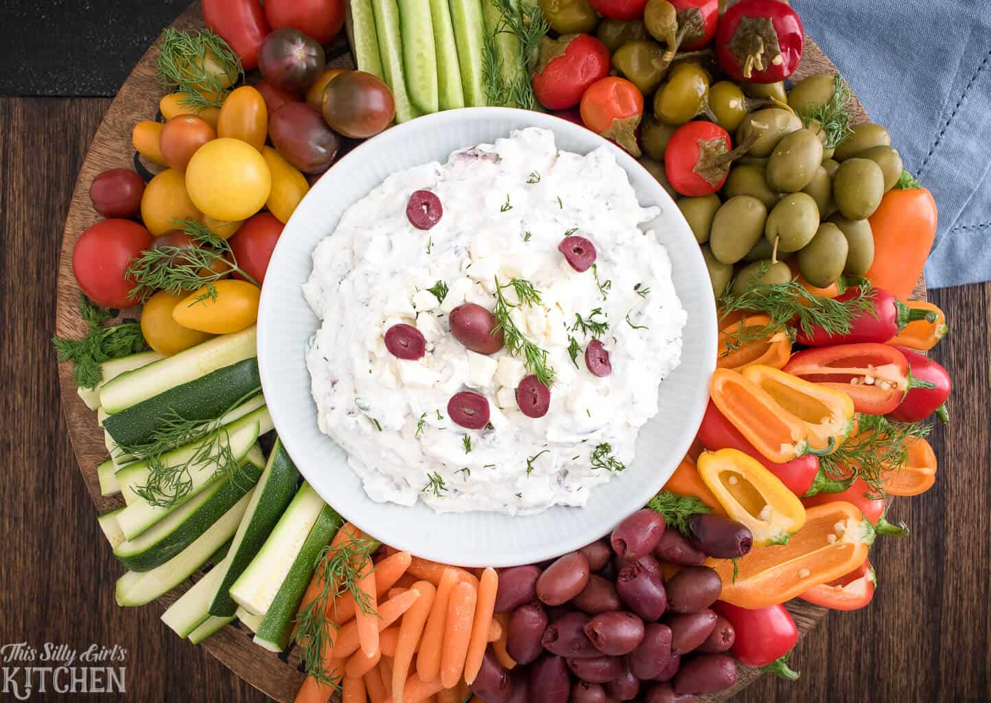 Greek Yogurt Dip, a creamy crowd-pleasing yogurt dip, loaded with traditional Greek flavors! #recipe from ThisSillyGirlsKitchen.com #greekyogurtdip #easy #greekyogurtdipforveggies