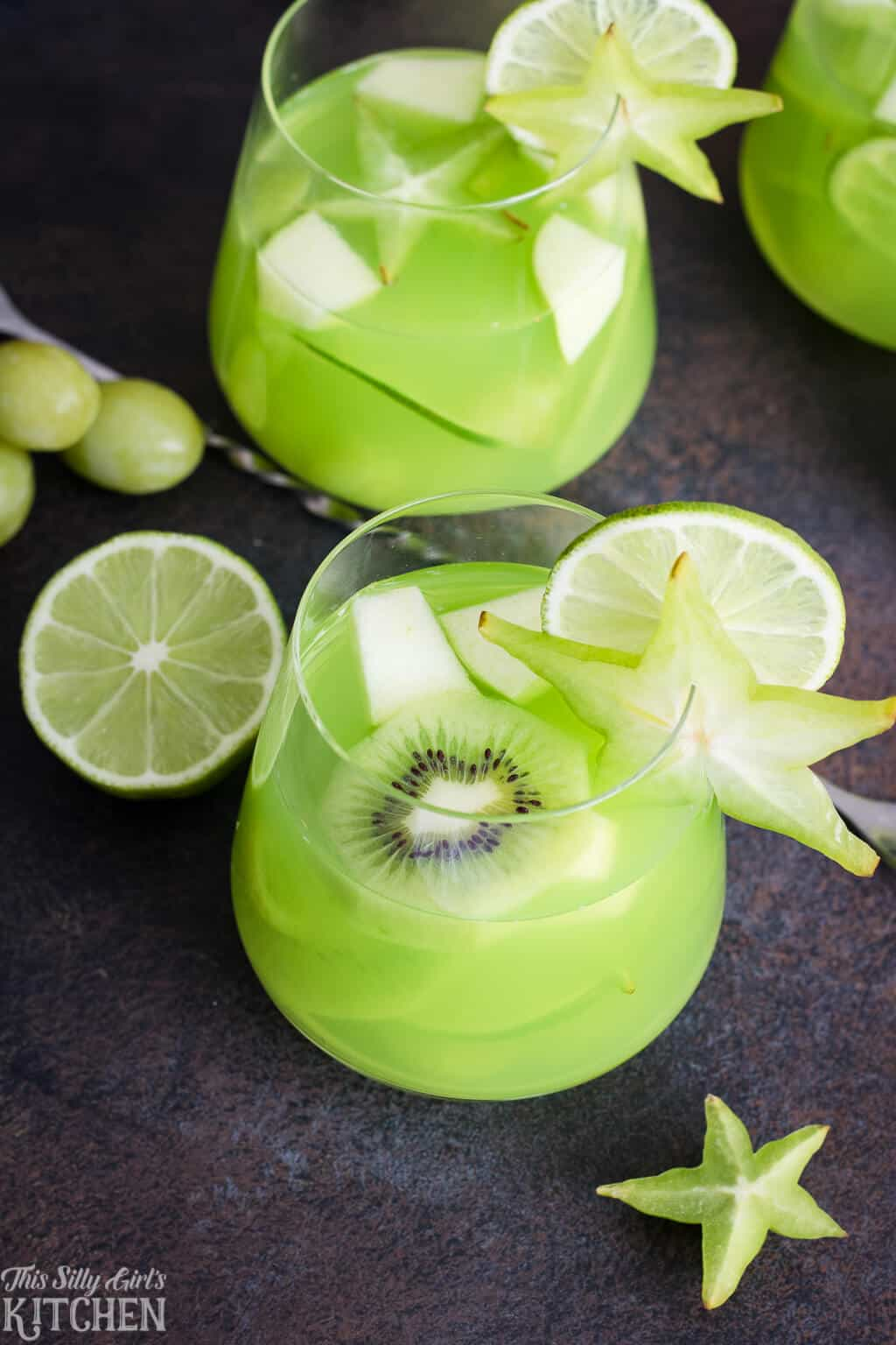 Virgin Green Party Punch, an easy and refreshing punch to serve at any party! #Recipe from ThisSillyGirlsKitchen.com #partypunch #punch #green #fruitpunch