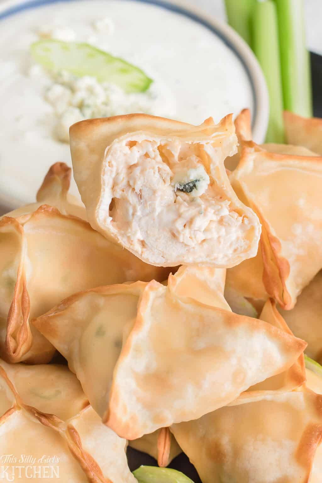 Buffalo Chicken Cream Cheese Wontons, only 6 ingredients and ready in 15 minutes, perfect for game day! #Recipe from ThisSillyGirlsKitchen.com #buffalochicken #wontons #airfryer