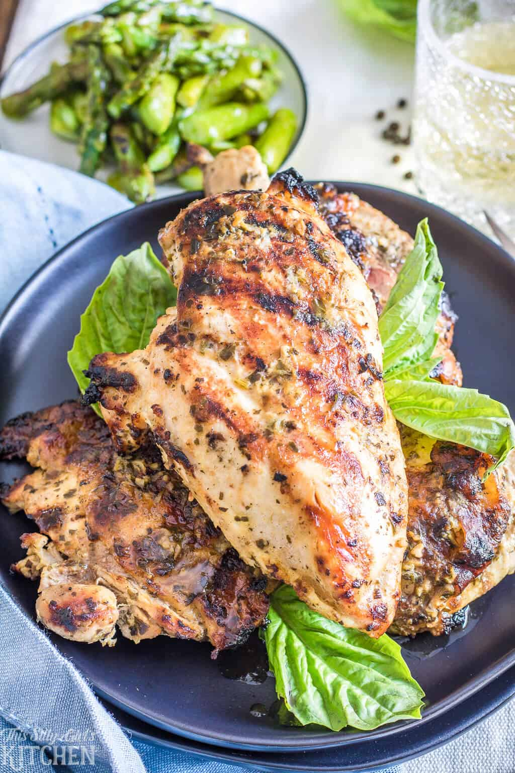 All-Purpose Pesto Chicken, an amazing pesto marinade for grilled chicken, a perfect addition to salads, pasta, and more! #recipe from thissillygirlskitchen.com #pestochicken #chicken #grilledchicken #chickenmarinade #pestomarinade