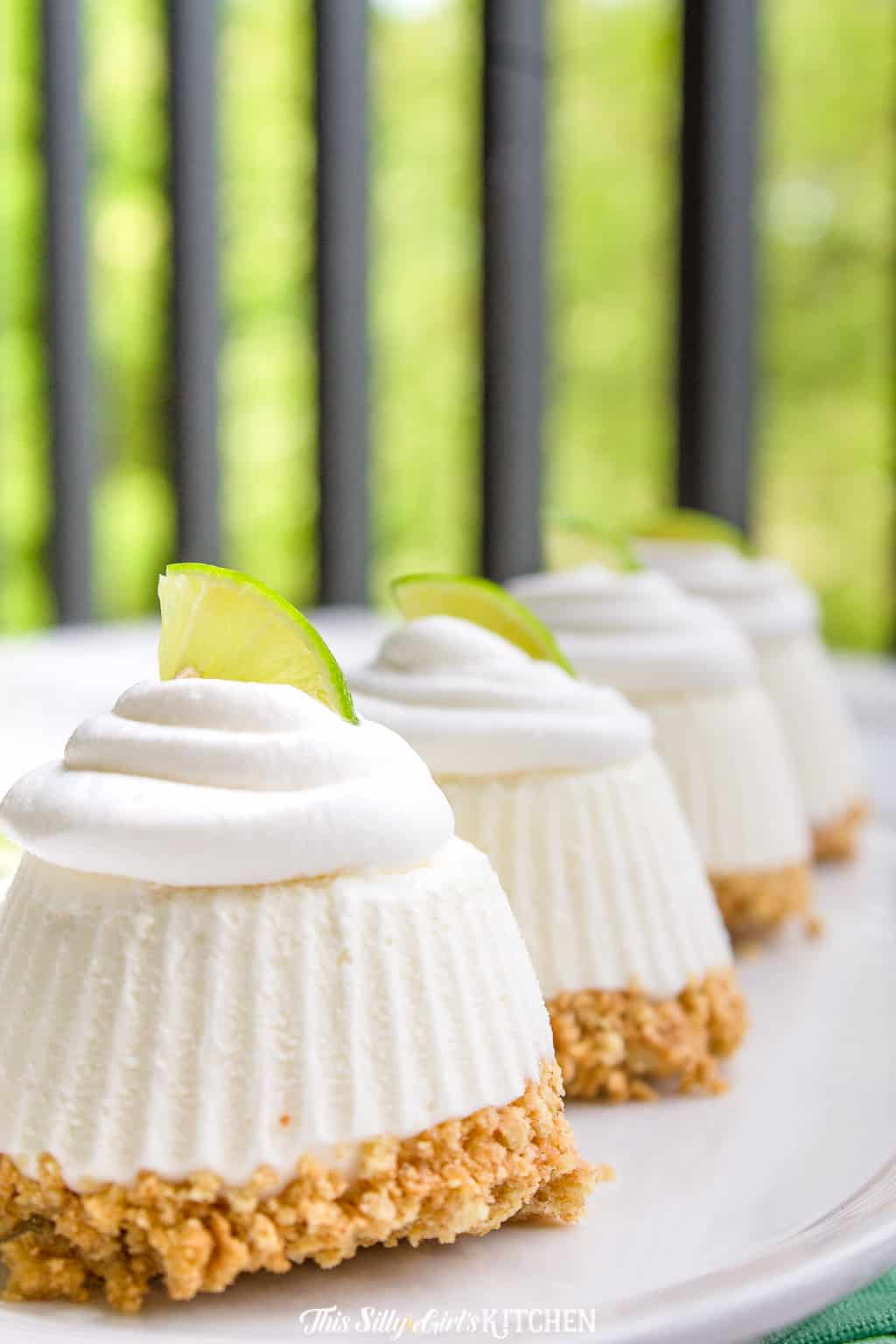 Key Lime Pie, cute little no-bake pies that will have your family raving for more! #recipe from thissillygirlskitchen.com #keylimepie #individualfrozenkeylimepie #keylime #summer #dessert #frozen #minikeylimepie