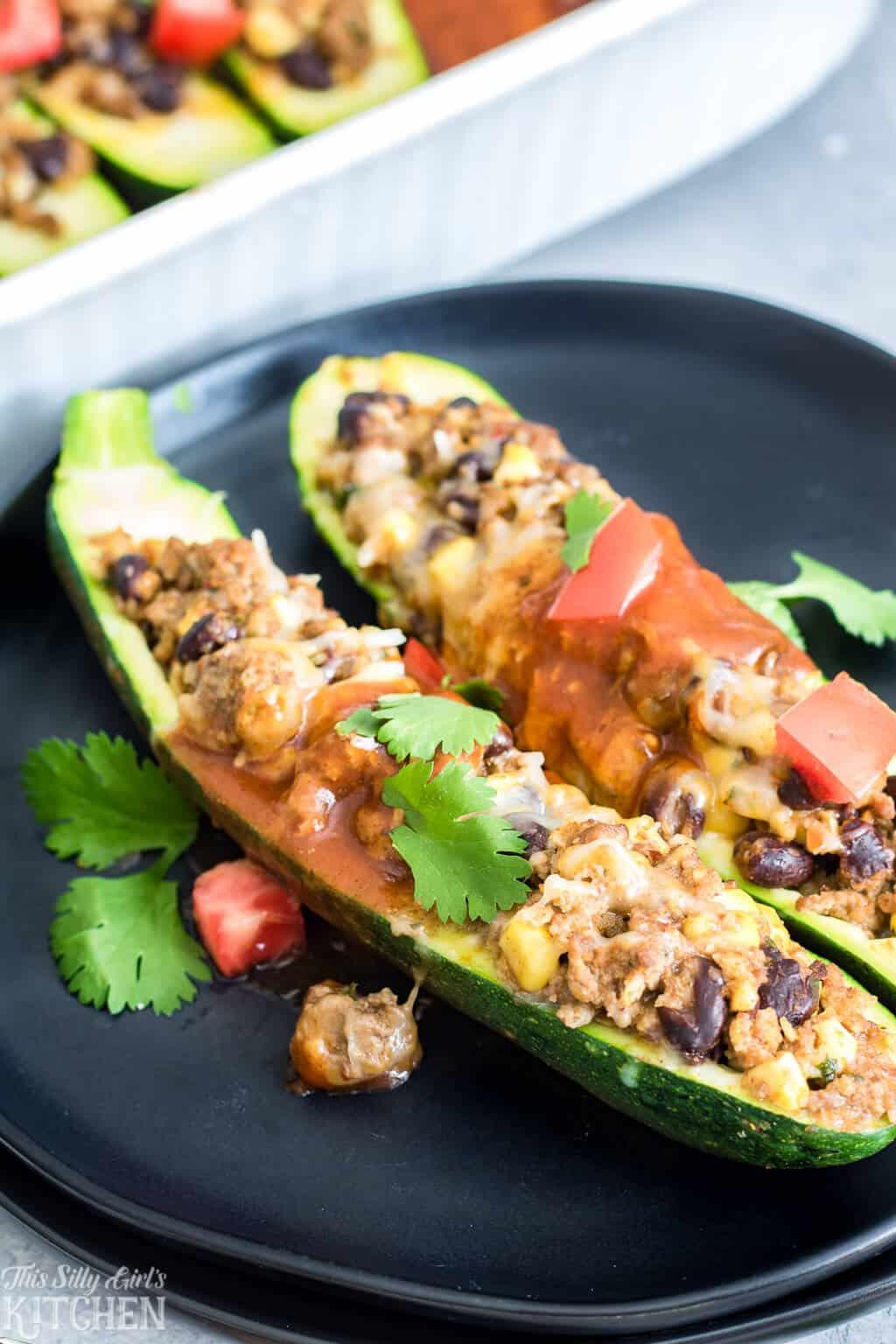 Enchilada Stuffed Zucchini, a satisfying, easy dinner the whole family will love! #Recipe from ThisSillyGirlsKitchen.com #Enchilada #StuffedZucchini