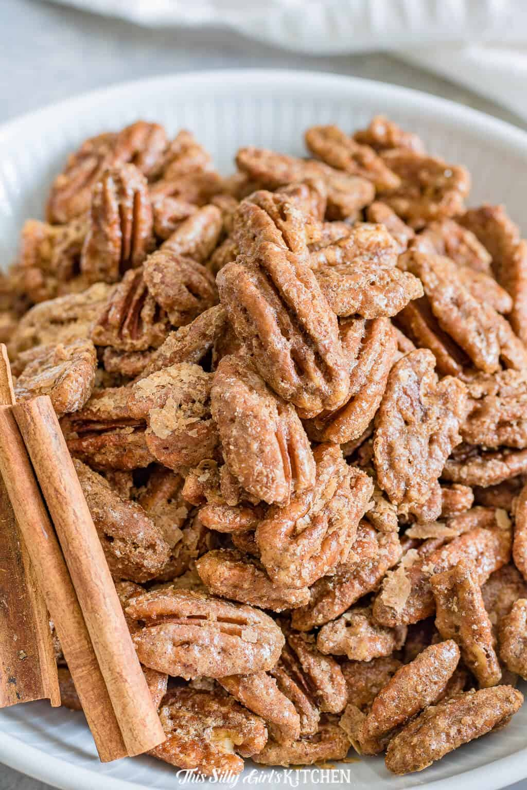 Cinnamon Sugar Roasted Pecans, sweet, crunchy, extremely easy and totally addicting! #Recipe from ThisSillyGirlsKitchen.com #pecans #candiedpecans #roastedpecans #cinnamon