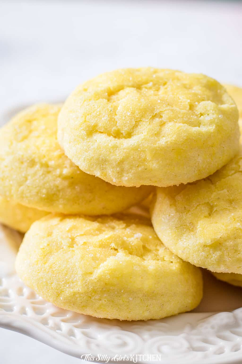 Lemon cookies made with cream cheese are tender, light as air, and literally, melt in your mouth. #recipe from ThisSillyGirlsKitchen.com #lemoncookies #lemon #creamcheesecookies #meltaway #cookies