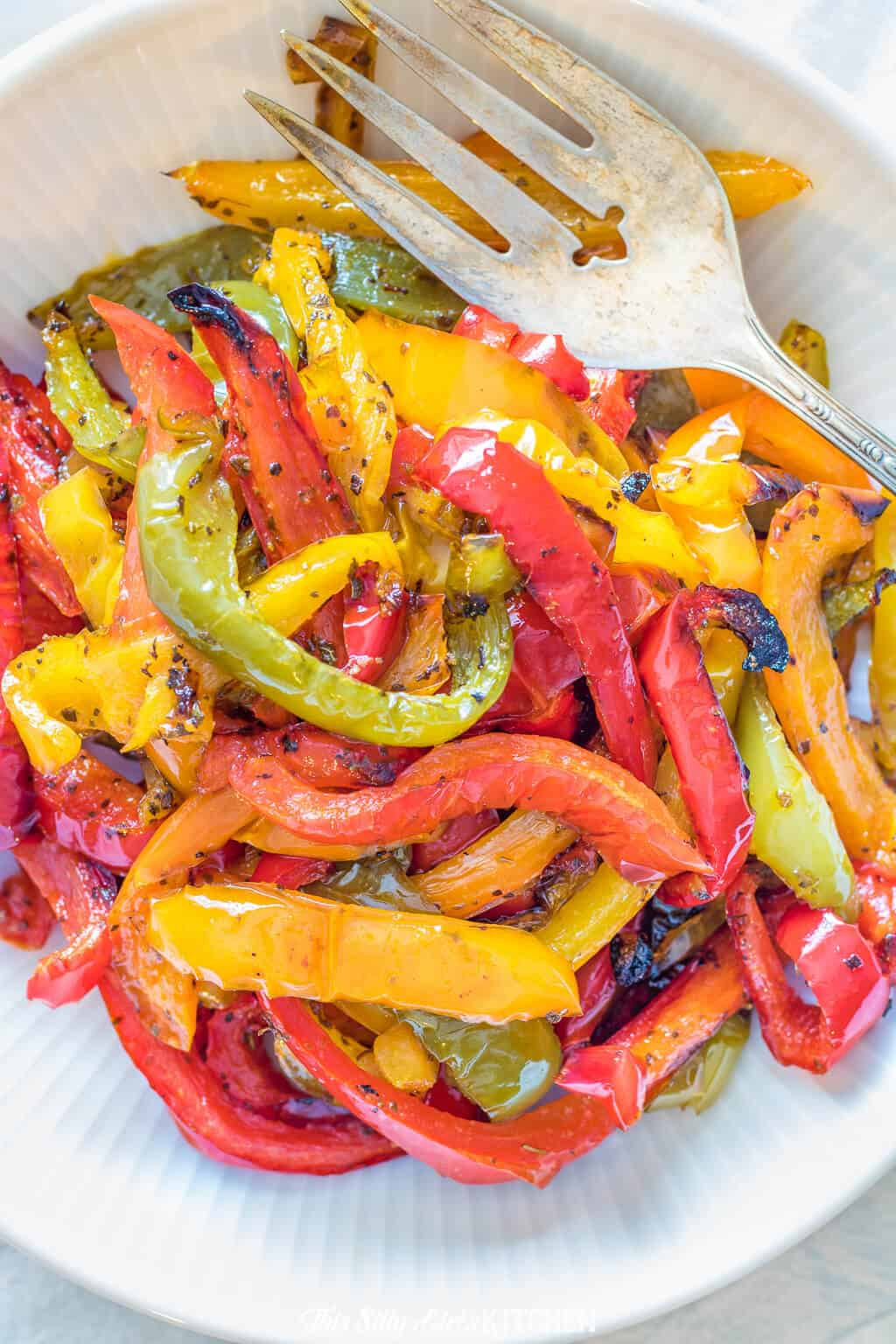 Roasted peppers make for a side dish or topping for many different meals. #recipe from ThisSillyGirlsKitchen.com #roastedpeppers #roastedredpepper #bellpepper #sidedish