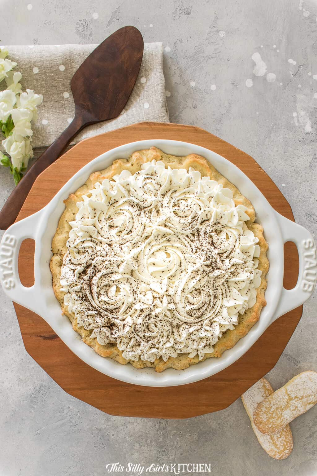 Tiramisu Pie, Layers of sweet mascarpone cream with ladyfinger cookies and fresh whipped cream all in an irresistiblepie crust. #Recipe from ThisSillyGirlsKitchen.com #tiramisu #pie #tiramisupie #tiramisurecipe #homemade