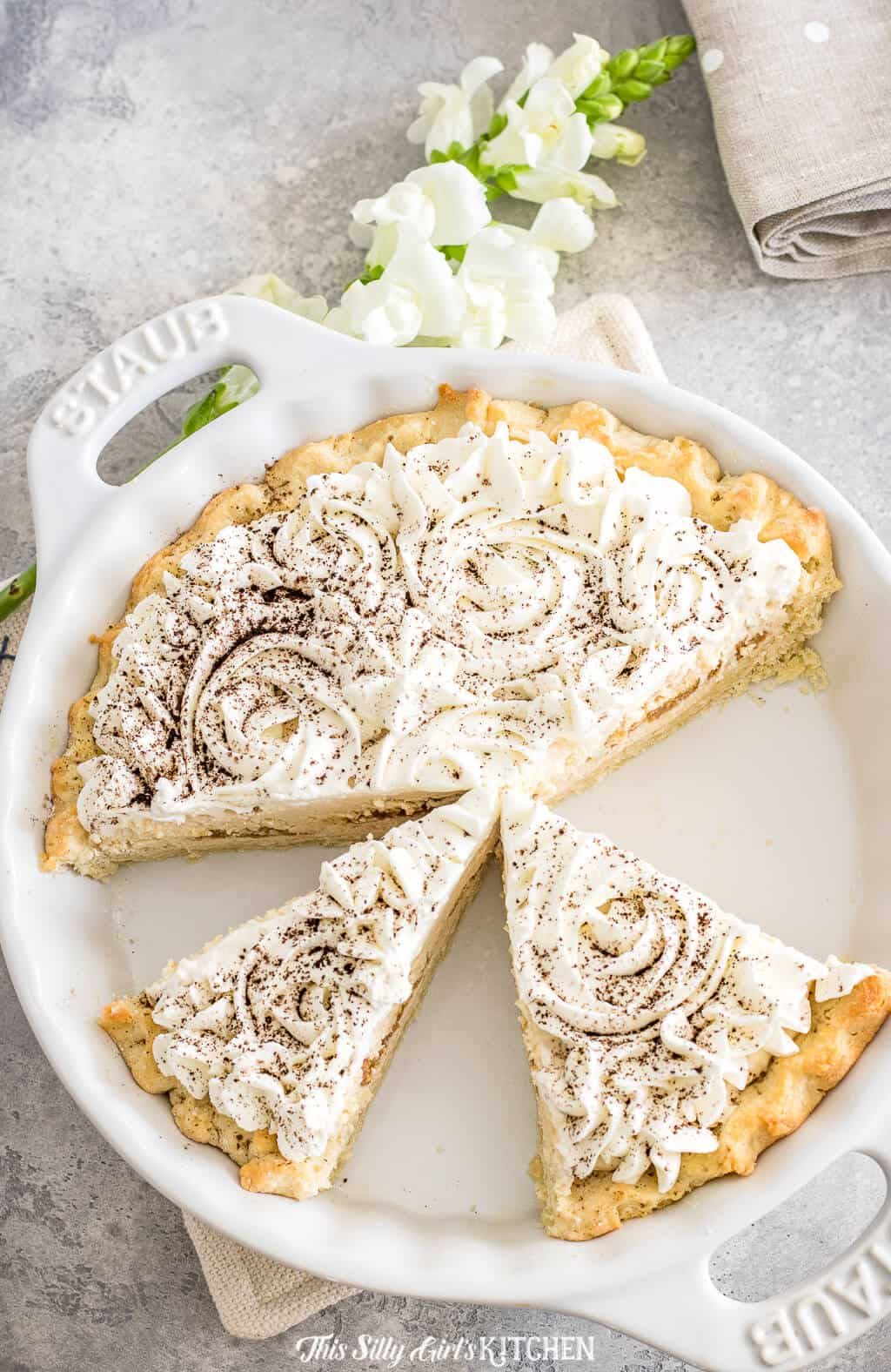 Tiramisu Pie, Layers of sweet mascarpone cream with ladyfinger cookies and fresh whipped cream all in an irresistible pie crust. #Recipe from ThisSillyGirlsKitchen.com #tiramisu #pie #tiramisupie #tiramisurecipe #homemade