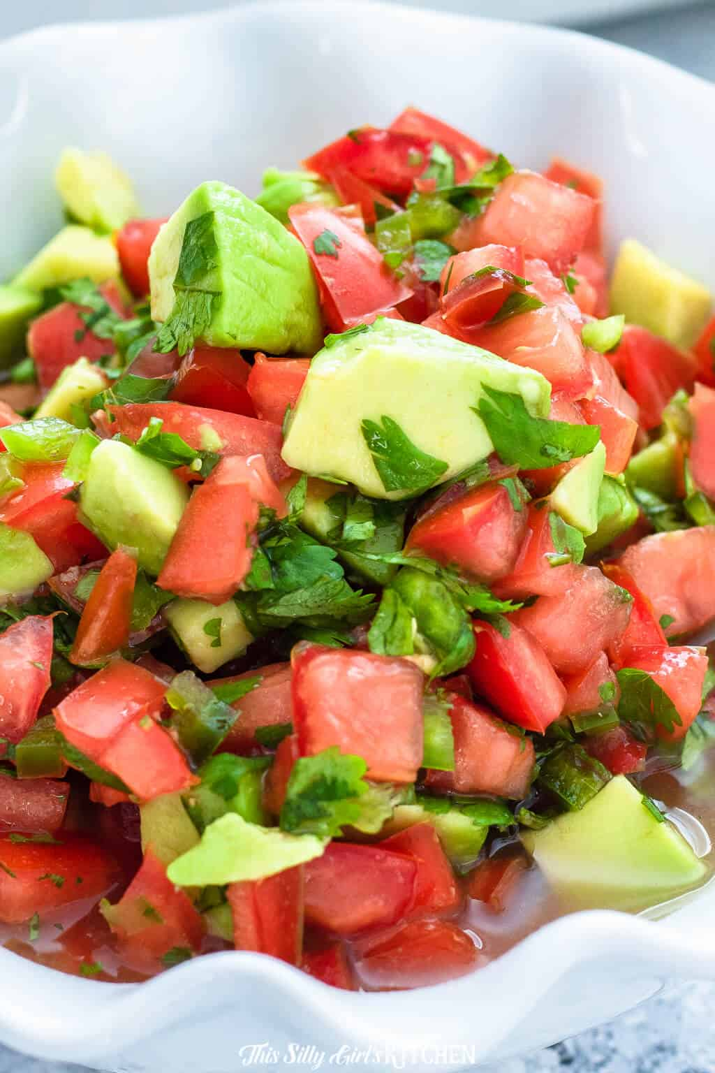 Avocado salsa, the perfect accompaniment to Taco Tuesday! #recipe from thissillygirlskitchen.com #avocadosalsa #salsa #avocado