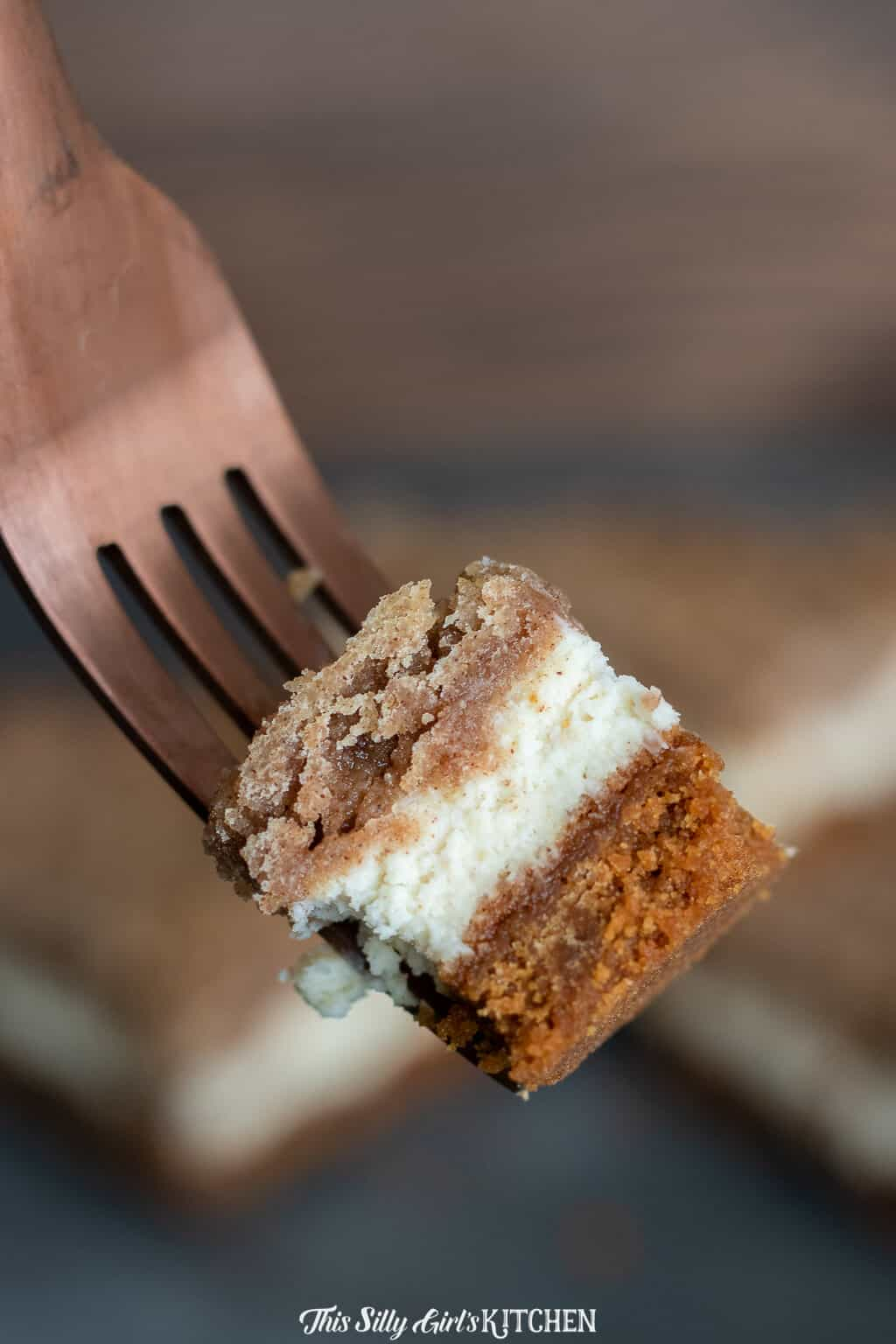 Snickerdoodle bars with cheesecake filling, a decadent cookie bar bursting with cinnamon goodness. #recipe from thissillygirlskitchen.com #snickerdoodle #cheesecake #snickerdoodlebars #cheesecakebars