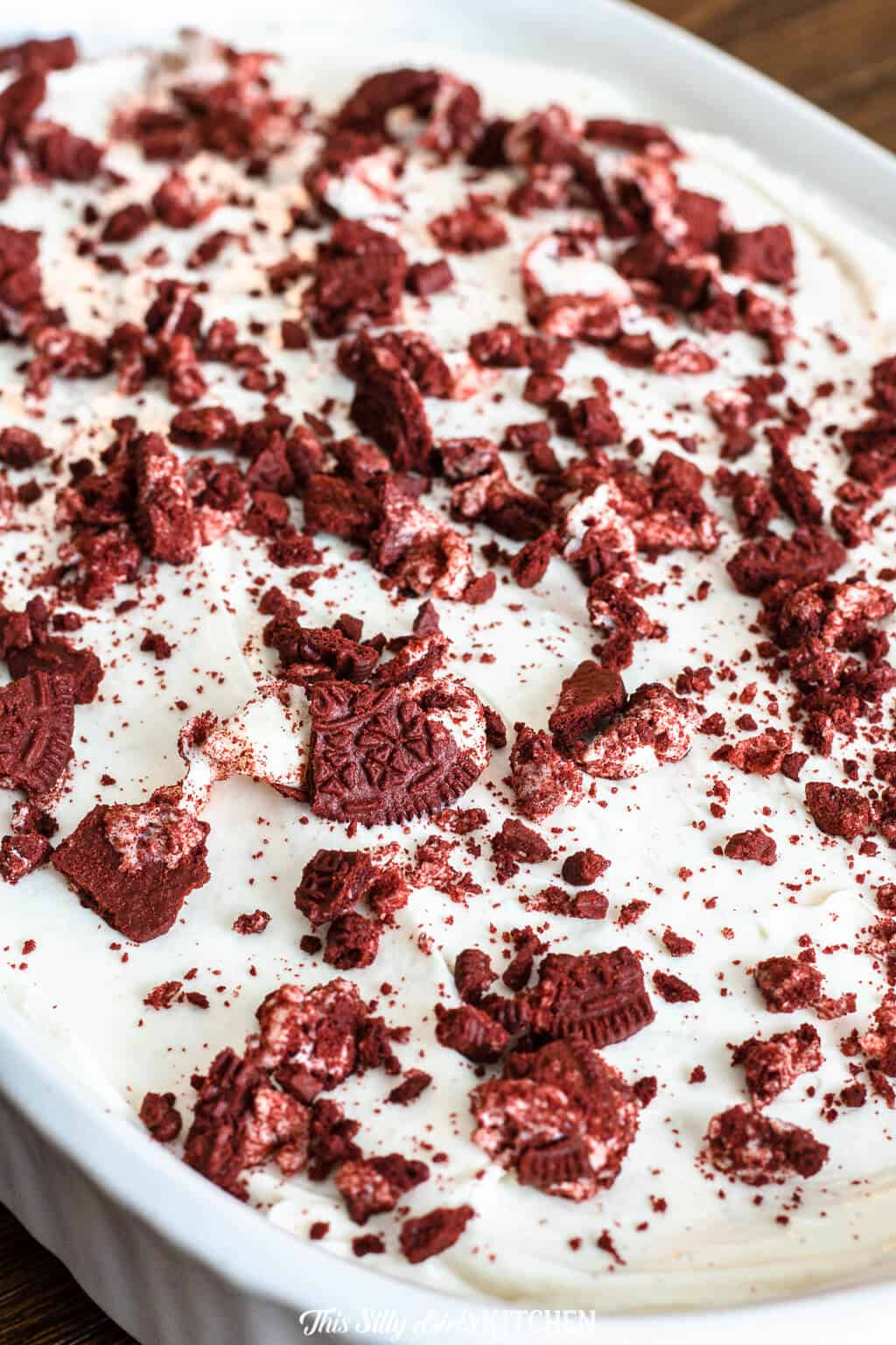Red Velvet Cheesecake Cake, red velvet cake with a surprise swirl of cheesecake throughout, topped with cream cheese frosting and crushed red velvet Oreos. #recipe from thissillygirlskitchen.com #redvelvet #cake #redvelvetcake #cheesecake #cheesecakecake #redvelvetcheesecakcake
