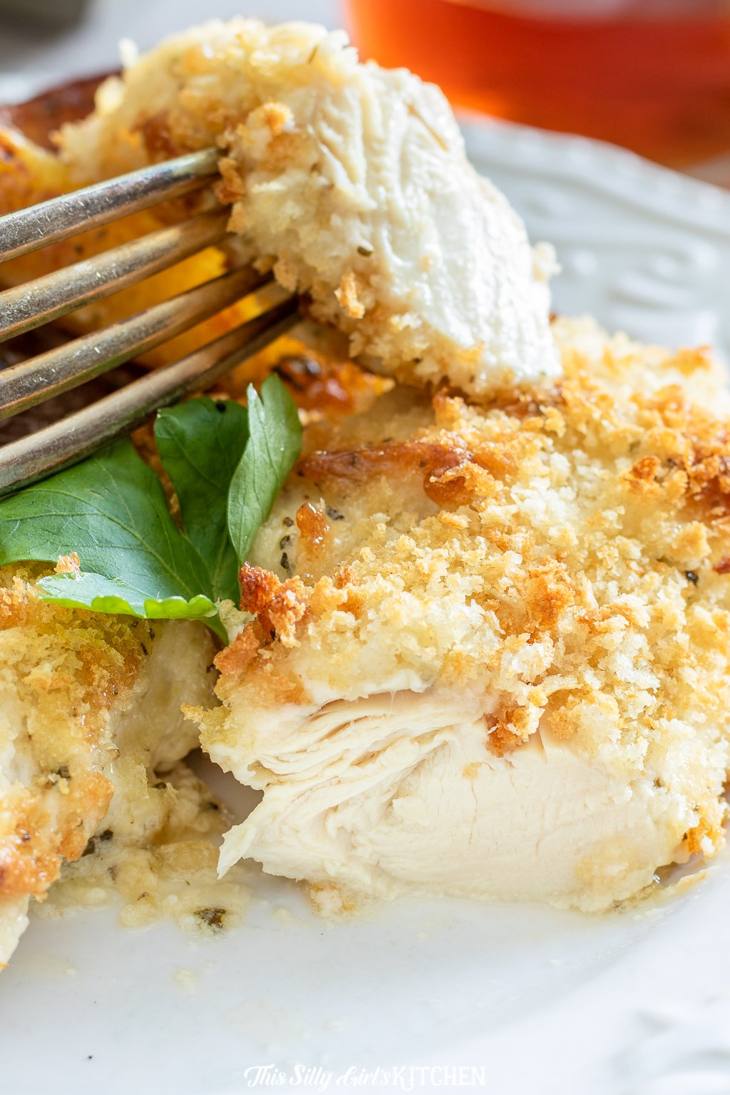 These chicken tenders are baked, with a flavorful parmesan coating that gets rave reviews each time I make them! #recipe from thissillygirlskitchen.com #chickentenders #bakedchickentenders #chicken #dinner #parmesan