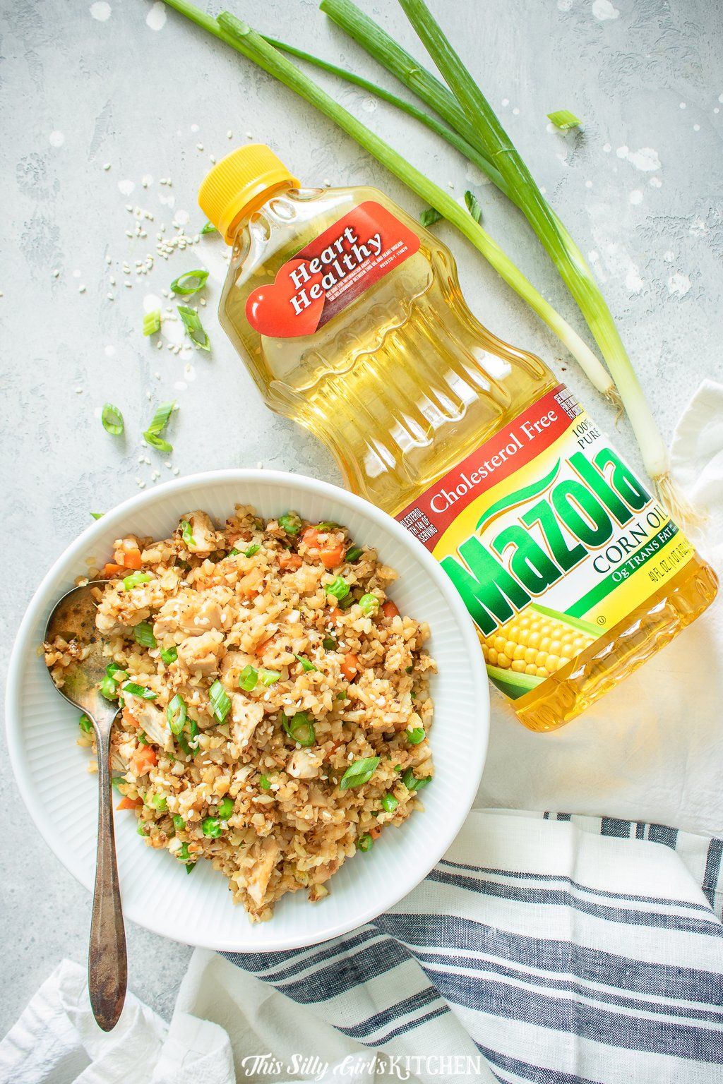 Loaded with veggies and chicken this cauliflower chicken fried rice is a healthier alternative to classic fried rice. #recipe from thissillygirlskitchen.com #friedrice #chicken #chickenfriedrice #cauliflowerrice