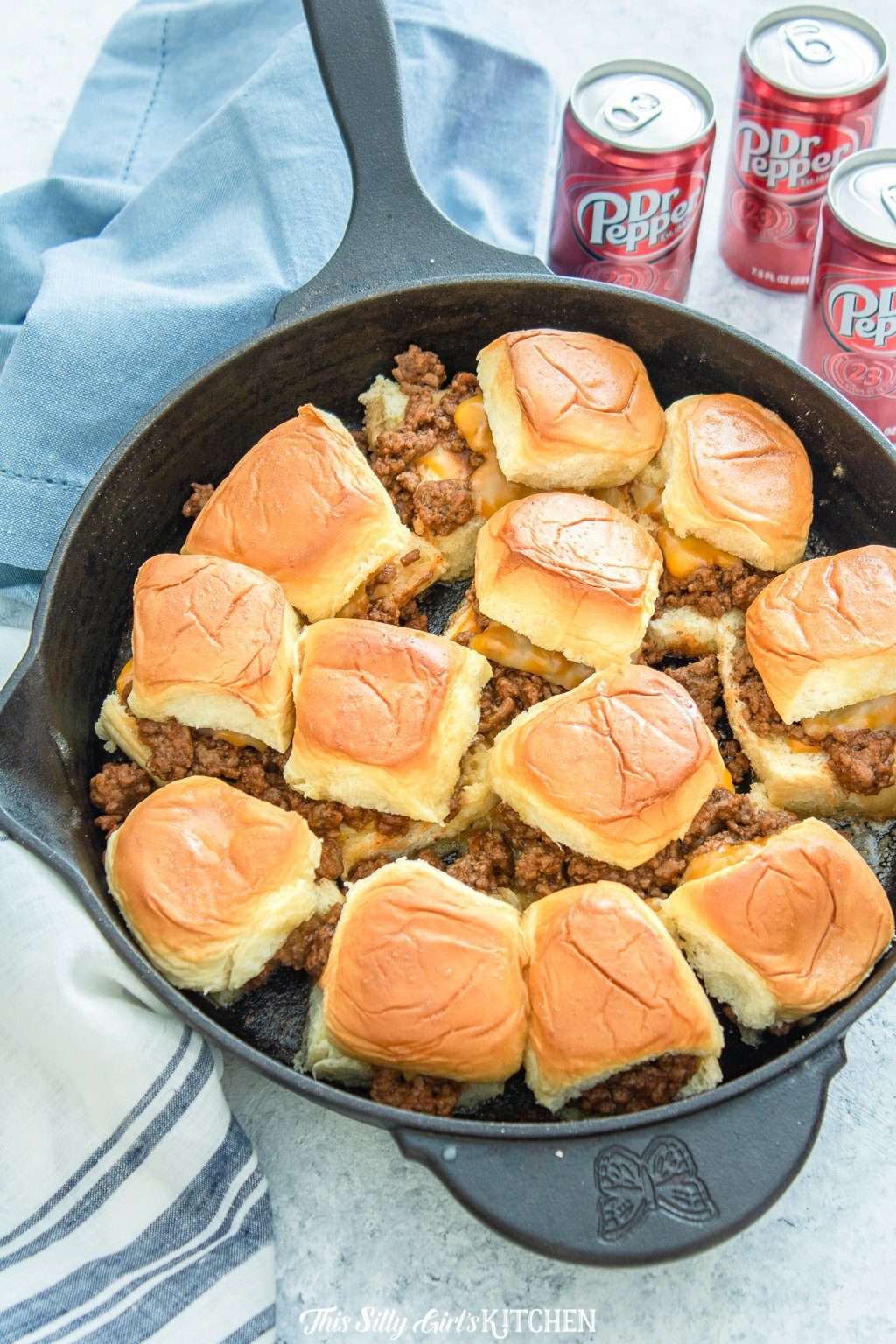 Sloppy Joe Sliders: Sloppy joe mix on top of slider buns with melty cheese and caramelized onions, baked until bubbly. #recipe from thissillygirlskitchen.com #sloppyjoe #sliders #gamedayfood