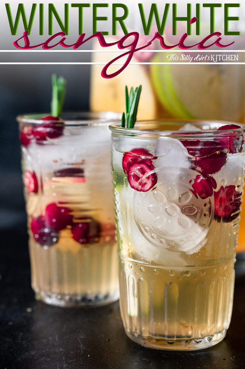 Close up of two glasses of Winter White Wine Sangria in glasses pinterest image