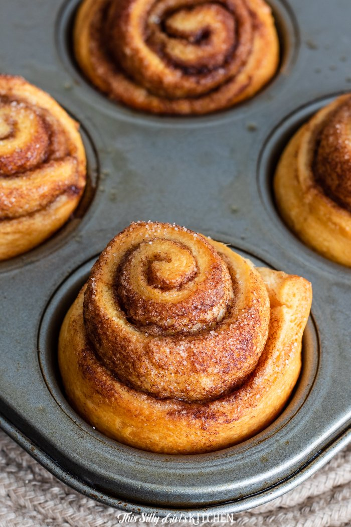 Baked cinnamon rolls in muffin tin