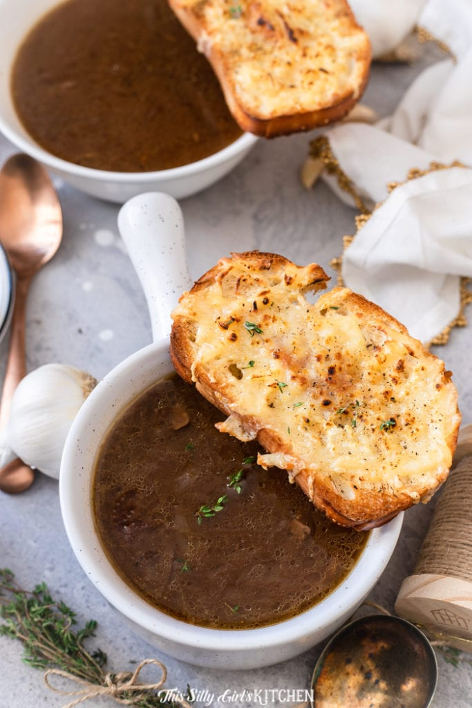 This French Onion Soup is so decadent and hearty, with a couple unique added twists! #recipe from thissillygirlskitchen.com #soup #frenchonionsoup #frenchonionssoup #crockpotfrenchonionsoup