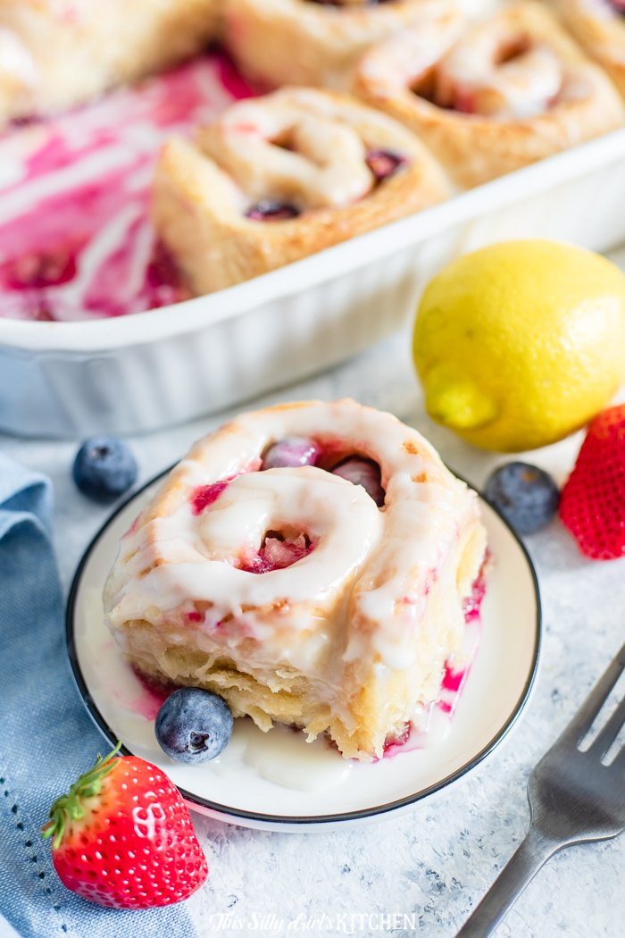 Lemon Berry Sweet Rolls - With a tender croissant dough, filled with berries, and an addictive lemon glaze, these sweet rolls will be your new go-to breakfast treat! #recipe from thissillygirlskitchen.com #sweetrolls #cinnamonrolls #berryrolls #lemonberry #berrysweetrolls #lemonberrysweetrolls #breakfast