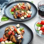 Square image of Sous Vide Chicken Caprese on two plates