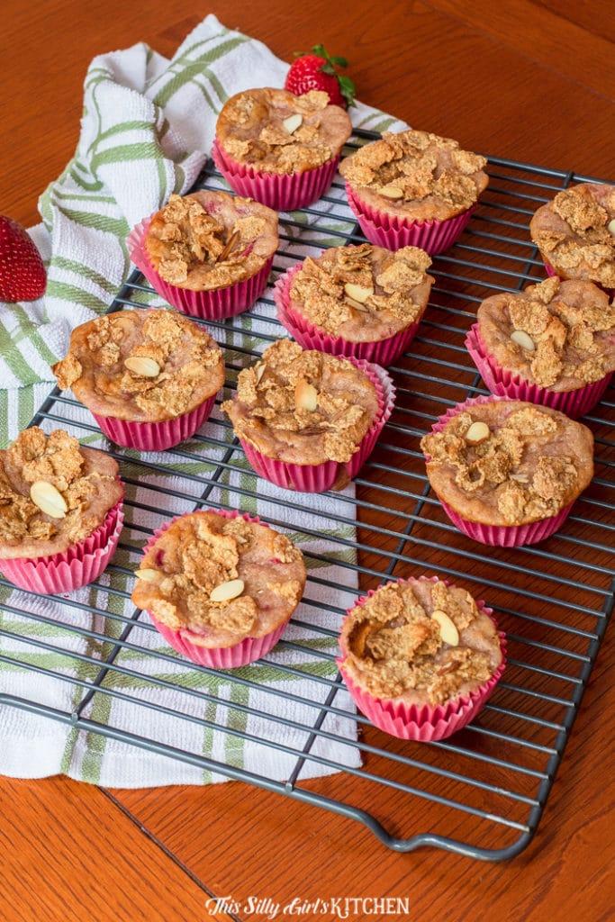 Almond Strawberry Yogurt Muffins, tender homemade muffins made with strawberry Greek yogurt and other deliciousingredients. #recipe from thissillygirlskitchen.com #muffins #yogurtmuffins #strawberrymuffins