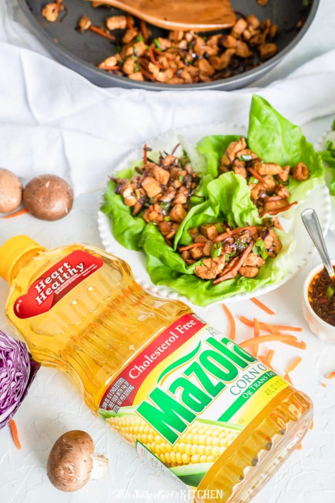 Chicken Lettuce Wraps, a popular restaurant appetizer easy enough to make at home! #recipe from thissillygirlskitchen.com #asian #Chinesefood #takeout #copycatrecipe #chicken #chickenlettucewraps #lettucewraps