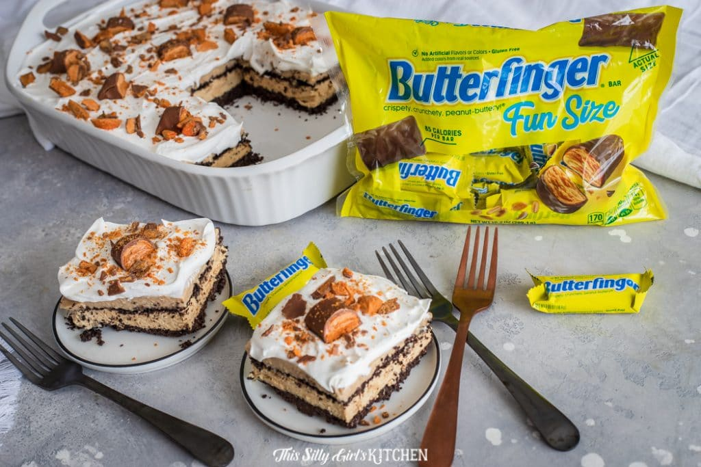 Peanut Butter Lasagna, layers of peanut buttery goodness! #recipe from thissillygirlskitchen.com #peanutbutt #peanutbutterlasagna #dessertlasagna #peanutbutterdessertlasagna