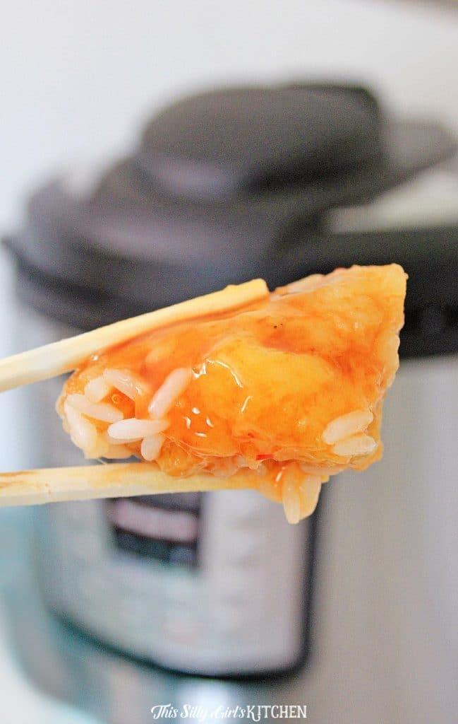 one piece of chicken shown with chopsticks