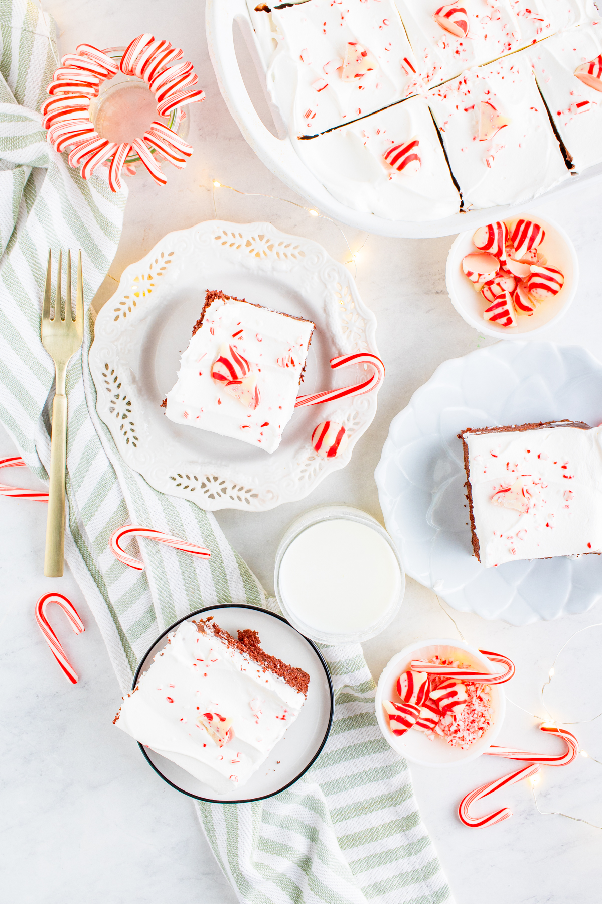 Overhead shot of three slices of cake on white plates