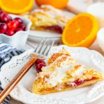 Cranberry Orange Braid slice on white plate