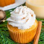 Close up of eggnog cupcake next to cinnamon stick