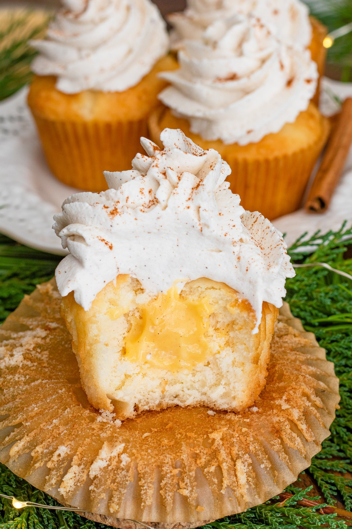 Eggnog Cupcake cut in half showing the filling