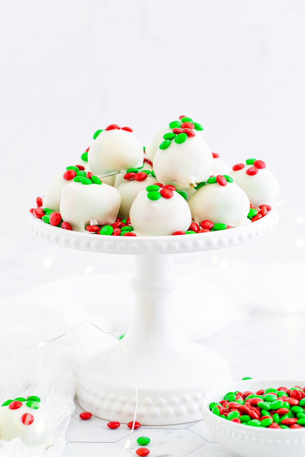 Cake stand stacked with Holiday Oreo Truffles