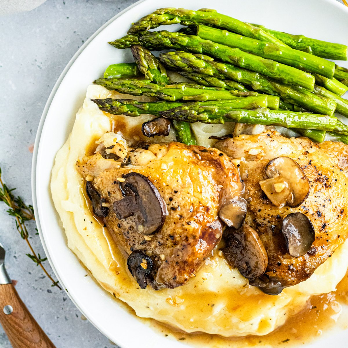 Close up of plated slow cooker marsala chicken thighs square image