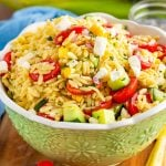 Orzo Pasta Salad in green serving bowl square image