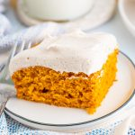 Square photo of one Pumpkin Bar on white plate frosted.